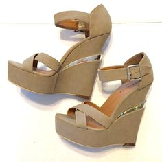 "MICHAEL ANTONIO Studio Taupe Platform Wedge 7.5 Michael Antonio Studio George Taupe Platform Wedges. Smooth Vegan suede Upper. Cupped heel & wraparound ankle strap with silver buckle. 1.5"" platform builds to a 6""wedge separated by silver. Cushioned insole, rubber sole. Worn twice! Smoke free, pet free. Michael Antonio Shoes Wedges"