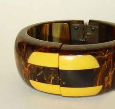 Sharp vintage root beer bakelite clamper.