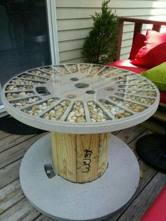 Table made from wooden spool. I spray painted with a stone finish and accentuated with gravel! Table made from wooden spool. I spray painted with a stone finish and accentuated with gravel!