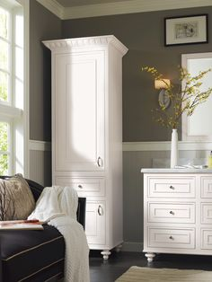 Beautiful Pure White cabinet foot and valance options paired with sleek cabinet#hardware create a breezy ambiance in this Omega Cabinetry bathroom haven. #OmegaBathCollection