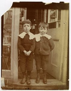 Outdoor camera snapshot portrait (gelatin silver print) of two young brothers or friends on a front door step, 1890-1900. Both little boys wear woollen knickerbocker suits with wide whitework collars and ankle boots. by manchestergalleries, via Flickr