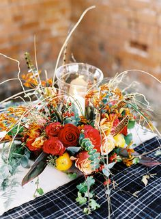 Table Flowers Rustic Christmas Wedding Ideas http://www.victoriaphippsphotography.co.uk/