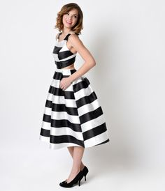 Have you ever seen such a charming confection, dears? A stunningly sculpted midi mod dress in a thick white and black st...Price - $58.00-fN5nqBhP