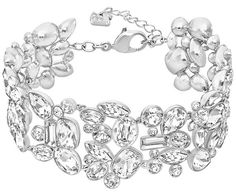 This statement bracelet gleams with a vast array of spectacular clear  crystals to create a beautiful vintage look. The rhodium-plated chain  closure is ... 8ffd04a8eba3