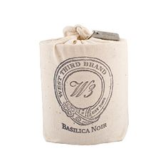 West Third Brand Basilica Noir Candle - Packaged in a hand stamped cotton sack adorned with an ages West Third metal tag. All cotton wick. $34