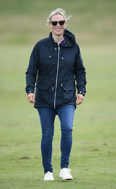 Zara Philiips looked cool and casual in a pair of blue jeans, white sneakers and a navy blue raincoat, and while the day may have been overcast, she opted for a pair of chic sunglasses. #RaincoatsForWomenNavy