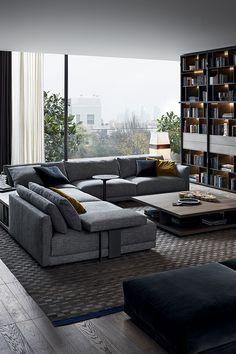Bristol Sofa by Jean Marie Massaud. Double backrest and modern lines. Grey modular sofa. Ottoman. Checkered rug.