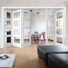 Thrufold Coventry Shaker 3+2 Folding Door - Clear Glass - White Primed - Lifestyle Image.    #whitefoldingdoors #interiorglazeddoors #interiorroomdividiers #door #doors #directdoors
