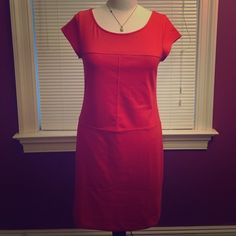 Banana Republic Bright Coral Dress Banana Republic bright coral dress. Short sleeves and scoop neck. Comes to just above the knee. Seaming decoration makes for a very flattering look in front and back!! Never worn!!Great fit, fun for the spring and summertime! In excellent condition ‼️‼️ Banana Republic Dresses Midi