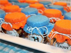 Party Favors: For her twin boys first birthday party, Mae Armstrong gathered up her own empty jars, filled them with treats, and topped them off with cute labels and fabric for perfectly sized jars of sweets that guests could take home.
