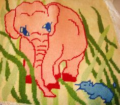 Pink Elephant Finished Needlepoint.  Design by Spinnerin.  I have no idea what the blue animal in the corner is supposed to be.