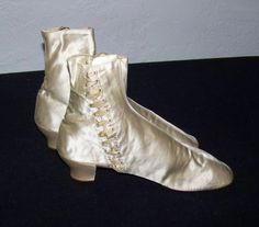 """1850s-60s silk satin wedding boots. Handworked eyelets, twill laces, covered heels. L9.25"""", W 1.25"""", heel ht 1.5"""", overall ht 6.5"""". Etsy seller ParlourGames."""