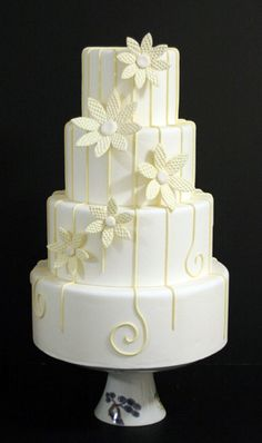Beach Weddings - Yellow graphic flowers with a white lacy overpiping on a white cake, by Mark Joseph Cakes Amazing Wedding Cakes, White Wedding Cakes, Amazing Cakes, Yellow Wedding, Cupcakes, Cupcake Cakes, Take The Cake, Love Cake, Pretty Cakes