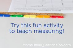 Teach your preschooler about measuring with a ruler using this fun activity! - Use math links, pompoms, or even toy cars. Free printable too! Moms Have Questions Too
