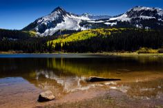 Lost Lake, Colorado fall colors aspen leaves snow mountains by mistyphoto