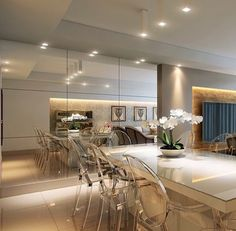 Sala de jantar por Karla Barros Arquitetura #espelho #living #mesalaqueada…