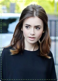 We're loving Lily's half-up half-down subtle bouffant hairstyle for medium length hair