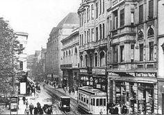 Historische Postkarte: Kortumstraße (ca. 1930) mit Kaufhaus Alsberg (das heutige Kortum) und Harmoniehaus