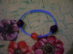 Bracelet with glass beads and caoutchouc