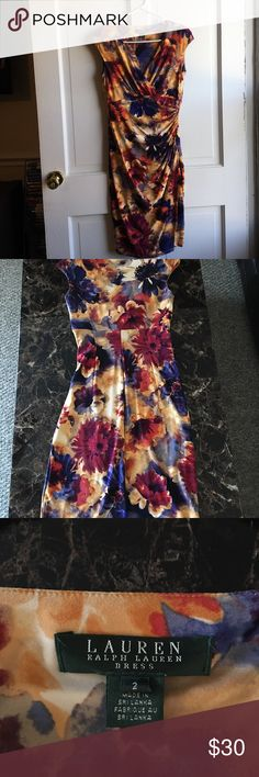 Ralph Lauren Cap Sleeve Dress Size 2 Dress is women's size 2. Thin shoulder pads. Dress looks new except for a few safety pin holes at the top which is shown in the picture. I pinned together to limit cleavage showing. Price firm. Ralph Lauren Dresses Midi
