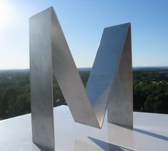 The Letter M Or The Letter W in Brushed Aluminum  by GraceParadise, $30.00