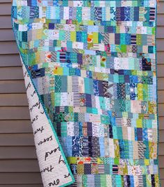 Lovely scrap quilt in blue strips
