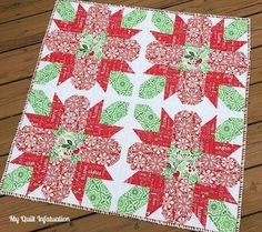 Traditional Poinsettia Table Topper | Add some traditional flair to your holiday table with this table topper!