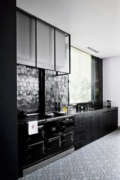 LOVING these cupboards! Custom glass panes like this can be expensive, but achieving the same design with window film is affordable and easy!
