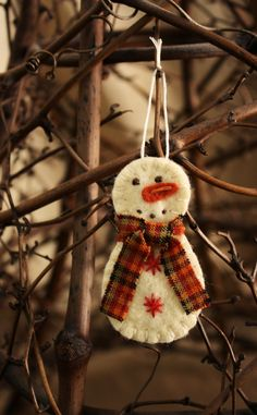 Kids safe felt ornament idea.  Love the plaid scarf on this guy!