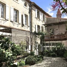 Tucked away on a medieval hilltop village in the Languedoc, Camellas-Lloret is a charming guest house dating back to the 18th century. They now offer 4 spacious rooms, all with private bathrooms, featuring original architectural details, marble fireplaces, and vintage furnishings mixed with modern design. A beautiful walled garden, terrace, and conservatory invite you to enjoy a quiet moment of relaxation or a gathering at the communal dining table. Walled Garden, Marble Fireplaces, Conservatory, Architecture Details, 18th Century, Invite, Terrace, Medieval, Modern Design