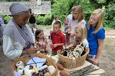 Kitty Wilson-Evans teaching children about the life of a slave in colonial times