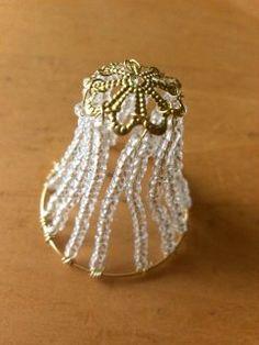 Miniature chandelier from jewellery parts | Nukkekodin hengetär  chandelier