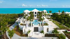 Experience Beachfront Bliss at This Vacation Villa in Turks and CaicosThe ultramodern villa includes two swimming pools, two cabanas, an outdoor movie theater, and more…  Rebekah Bell