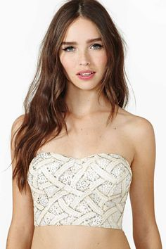 Monroe Sequin Bustier would wear with daisy duke jean shorts and a jacket and hat with hair down and combat boots