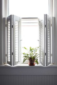 Create privacy in a bath with faux-wood window shutters. They're mold- and mildew-resistant, won't warp, and never need painting.