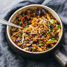 Cabbage and ground beef stir fry dinner served in a bowl with a fork