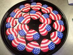 American flag red white and blue cookies made with a heart cookie cutter.