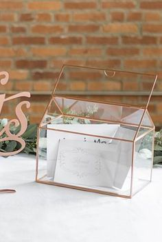 A simple yet elegant way to catch the cards you receive on your wedding day, this house-shaped glass holder features gorgeous rose gold edging. Place on a reception table or near the guest book for a Bridal Party Tables, Wedding Favor Table, Wedding Reception Table Decorations, Wedding Guest Book, Wedding Centerpieces, Centerpiece Ideas, Homemade Wedding Favors, Wedding Gifts For Guests, Unique Wedding Favors