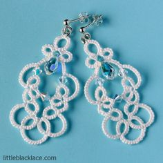Check availability in littleblacklace shop on Etsy!Delicate lace design in off-white colour. Simple and elegant earrings with Swarovski crystals (one drop-shaped and three bicones), ideal for strapless wedding gown. Sterling silver (925) findings – studs with small balls and jump rings.