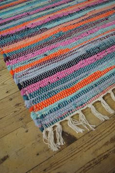 Fab! hand made rag rugs, in a wonderful combination of random rainbow colours.  Size approx:- 75 x 135cm. Material:- 100% recycled fabric.