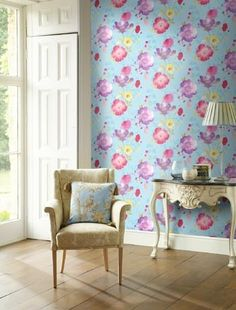 Turn a wall into an art feature wall with watercolour floral wallpaper. Lovehome.co.uk: