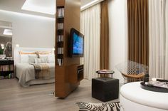 A similar concept can be seen here where the TV is mounted on a rotating wall