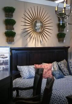 What a great idea... they hung bundled greenery (only meant to sit on a tabletop) on the wall -- great things come in multiples!