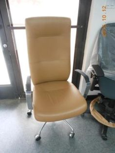 This high back camel leather executive chair just came in today. This is a brand new chair and we can order more they also come in other colors. Come in and pick up this chair today for you're home or