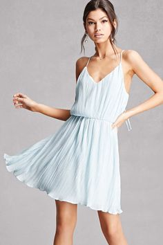 A woven cami dress featuring an accordion pleat, V-neckline, an elasticized waist, sleeveless cut, and a lettuce edge hem. This is an independent brand and not a Forever 21 branded item.