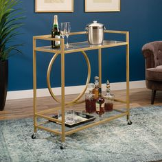 This rolling bar cart is a great way to stylishly entertain your guests. Display glassware on the glass top and store bottles on the shelf below. Additional bar cart features include:  Two, safety-tempered glass shelves features silk-screened geometric pattern. Casters for mobility with two locking. Finished on all sides for versatile placement. Metal construction. Satin Gold finish.