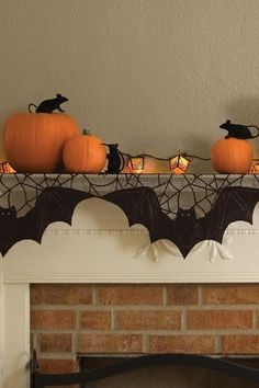 Mantel Scarf: This black bat and mouse scarf will make your mantlepiece just a little bit creepier. Click through for more Halloween decor with a touch of elegance.