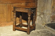 "LATE ELIZABETHAN CARVED OAK JOINT STOOL. ENGLISH. CIRCA 1590.    THE ORIGINAL PLANKED TOP ABOVE A CARVED FRIEZE WITH INTERLACED C SCROLLS, STANDING ON HEAVY ANCANTHUS CARVED CUP AND COVER LEGS JOINED BY STRETCHERS.  18.5"" WIDE X 21"" HIGH X 10.5"""