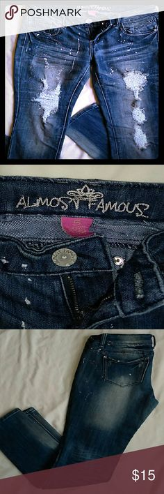 Almost Famous skinny jeans Awesome Sassy and ready to Party Size:5 These go with some heals OR Through on some flats to get a punk rock look! Made with a fashionable paint Splash look and fades to accentuate the legs Almost Famous Jeans Skinny