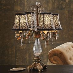 Exotic cheetah print always goes with everything bejeweled animal leopard shade lamp from midnight velvet with waterfalls of faceted glass accents this table lamp borrows from crystal chandeliers but spices up the look aloadofball Image collections